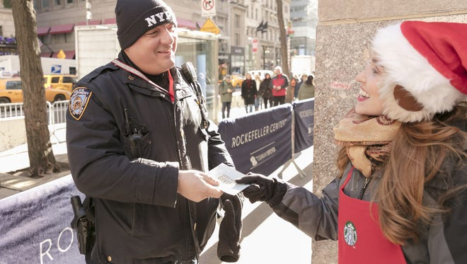 The Starbucks Give Good squad handed out gift cards in New York City. They'll be in Indy on Wednesday.