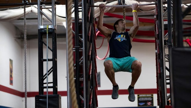 Kyle Soderman competes through obstacle courses that require strength and agility.