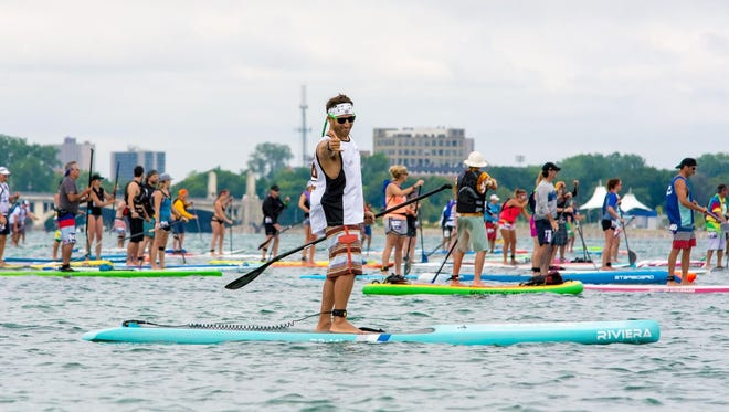 Kevin Cansiani, a GM engineer working on autonomous vehicles, unwinds by competing in stand-up paddleboard races including the intensely competitive and popular Once Around Belle Isle (OABI) race.