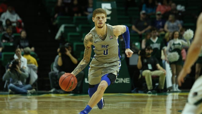 MTSU guard Tyrik Dixon dribbles up the court in a game against UAB at Bartow Arena in Birmingham, Ala., on Dec. 30, 2017.