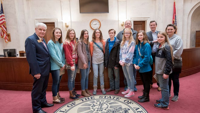 State Representative Jack Fortner (District 99) gave a tour of the Arkansas State Capitol to Pre-AP Social Studies eighth-graders from Bergman in Boone County on Wednesday afternoon. The students visited the Treasurers Office, the Old Supreme Court, State Senator Scott Flippo (District 17) in the Arkansas Senate chamber, and the House floor of the Arkansas House of Representatives. The legislators were proud of the students and the way they conducted themselves. Pictured are the students, Rep. Fortner, Sen. Flippo and teachers Camille Curtis and Scott Cox.