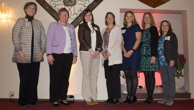 Honored at this year's MPACTE awards banquet were, left, Tammy Pitts of Agnesian; and Moraine Park President Bonnie Baerwald, JoAnn Giese Kent, Barbara Brown, Melissa Schmidt, Michelle Duran and Bonnie Bauer.