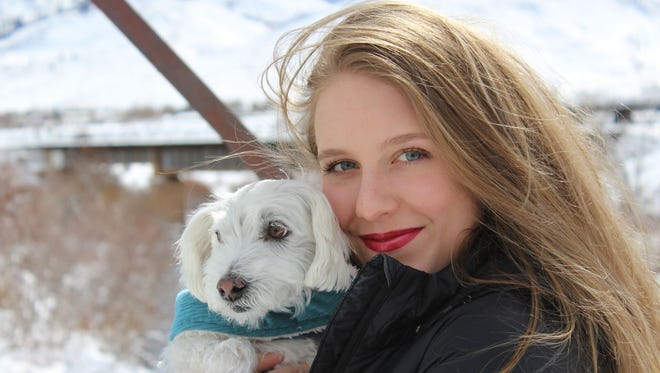 Annika Kerns and her dog Buster pose for a picture in Verdi on March 3, 2018. Moments after this picture was taken Annika was hit by a train.