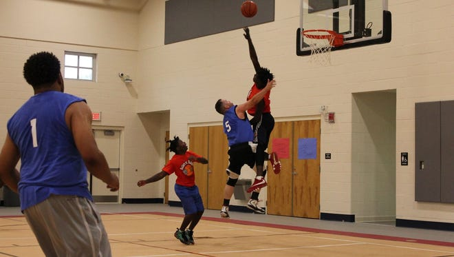 Success Academy students takes on the Leon County Sheriff's Office basketball team on April 28.