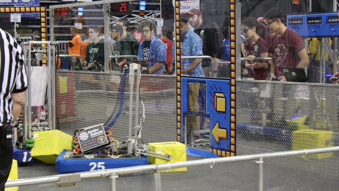 As members of the Raider Robotix drive team from North Brunswick Township High School look through the plexiglass at the field, FRC Team 25's robot races to place a cube through the portal to score points during the FIRST Mid-Atlantic Robotics District Championship conducted at at Lehigh University April 7 and 8. The North Brunswick team was one of eight from Central Jersey to qualify for the FIRST World Championship, being held in Detroit, Michigan, later this month.