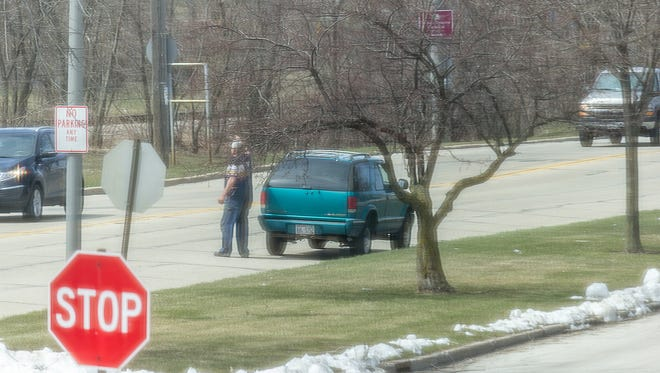 A concerned citizen took this picture of a man who is attracting a lot of attention on social media in the South Shore suburbs for aggressive panhandling