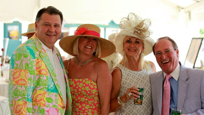 Bright dress and spectacular hats are the norm at the Ellis Park Kentucky Derby party.