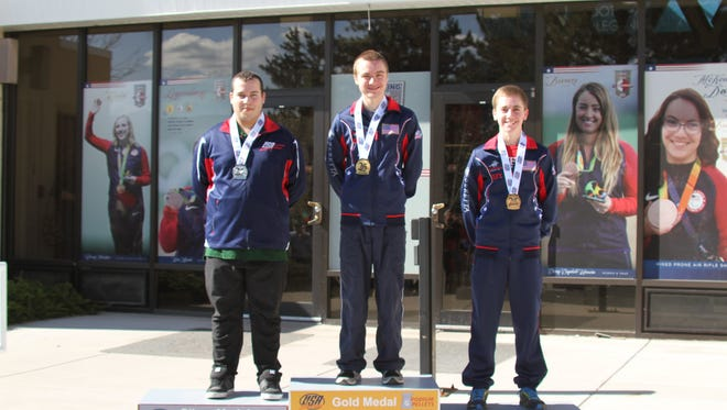 Jonestown resident Kyler Swisher, left, captured the silver medal in Men's Air Pistol at theNational Junior Olympic Shooting Championships in Colorado Springs last month.