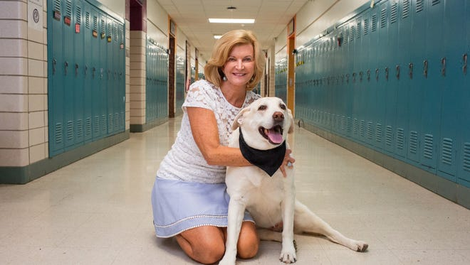 Millie the therapy dog poses with her owner Tracy Lepeltak, a counselor and dean of students at Cowles Montessori. The pair are retiring this school year.