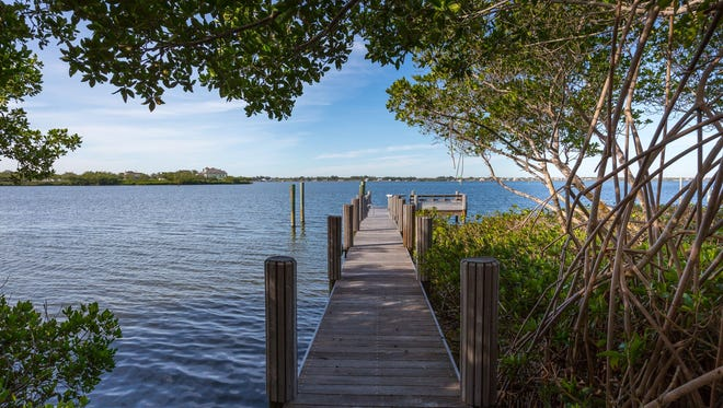The estate's private dock at 719 Grove Place, Vero Beach. In addition to the main home, there are two guest houses, each with bedroom and bath.