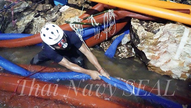 A handout photo made available by Thai Navy Seal on July 4, 2018,  shows Thai Navy officers and rescuers work inside a cave complex during the ongoing rescue operations for the child soccer team and their assistant coach, at Tham Luang cave in Khun Nam Nang Non Forest Park, Chiang Rai province, Thailand.