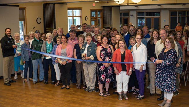 Plymouth's Generations Intergenerational Center cuts the ribbon celebrating their recent wall renovations and patio expansion.