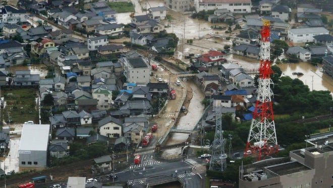 This picture shows an aerial view of flooded houses in Saka Town, Hiroshima prefecture on July 7, 2018.