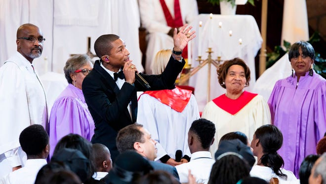 "This Sunday, Nov. 1, 2015 photo provided by A+E Networks shows Pharrell Williams performs the song ""Freedom"" as part of the ""Shining A Light: A Concert for Progress on Race in America,"" at Emanuel A.M.E. Church in Charleston, S.C."