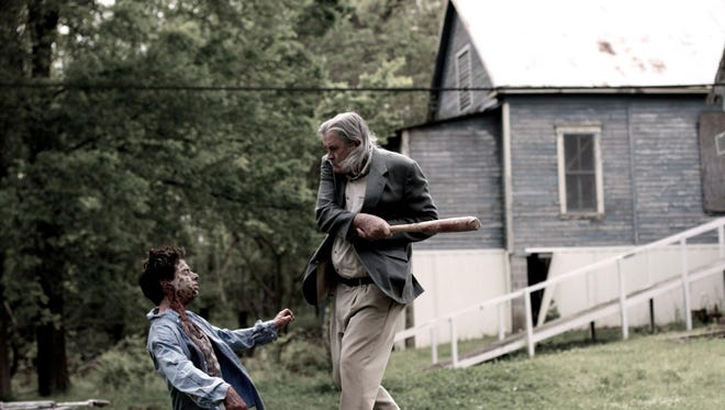 """A screen grab of Oxford resident Johnny McPhail's character fighting a zombie in the film """"Last Call."""""""