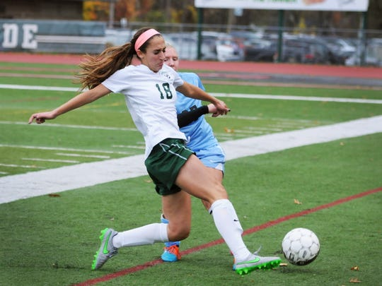 Ramapo senior Sarah Scire (no.18) battles against Jen Moutenot (no.27) of Mahwah for a loose ball in the first half of their game in North 1, Group 2 sectional final, at Ramapo High in Franklin Lakes, Nov. 12, 2015. Ramapo won the final 5 to 3.