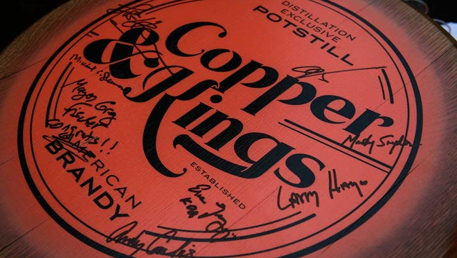 A Copper & Kings American Brandy Co. barrel top signed by members that made the new distillery possible.