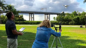 Videographer Ilene Saffron of Main Sail Video Productions demonstrates drone technology that will be used in the city of Fort Myers' live aerial video promotion series on Facebook for the next two months.