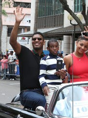Tampa Bay Buccaneers quarterback Jameis Winston, left, brother Jonah Winston, center, and girlfriend Breion Allen ride in a Martin Luther King Jr. Day parade Jan. 16, 2017, in St. Petersburg, Fla.