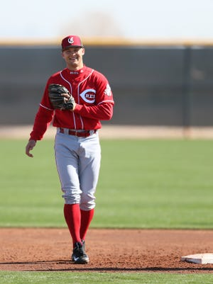 Cincinnati Reds third baseman Nick Senzel (79) smiles during drills, Tuesday, Feb. 20, 2018, at the Cincinnati Reds Spring Training facility in Goodyear, Arizona.
