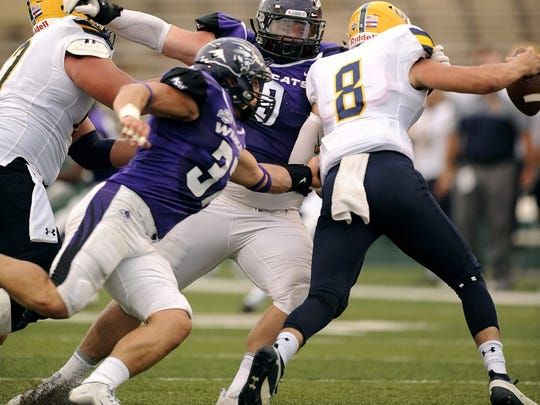 Thomas Metthe/Reporter-News Abilene Christian defenders Dylan Douglass (37) and Josh Bloom (9) chase after Northern Colorado quarterback Kyle Sloter (8) during the second quarter of the Wildcats' 55-52 loss on Saturday, Sept. 10, 2016, at Shotwell Stadium.