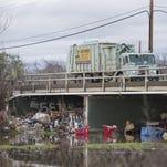 Trash pile raises questions