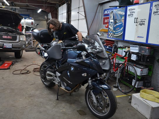 Marcin inspects the BMW F800ST.