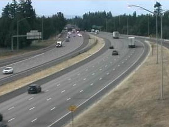 Traffic flowing on I-5 at the Portland Road exit.