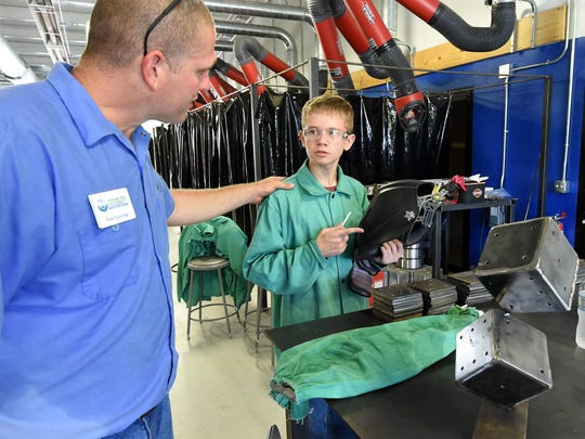 Rick Hastings, left, ASUMH welding instructor, talks with Benjamin Gunter, 13, of Whiteville, on Tuesday about welding techniques.