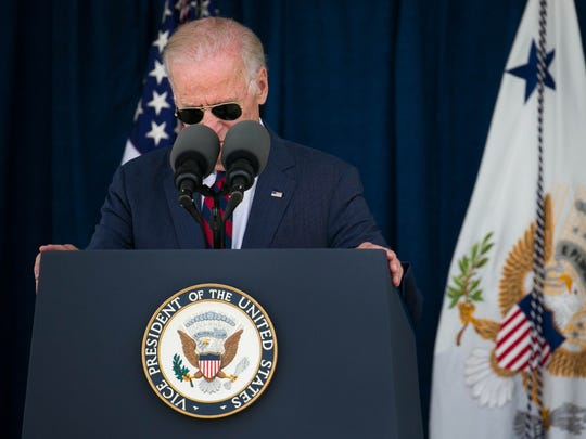 """Vice President Joe Biden pauses as he shares stories about his son Beau during a dedication ceremony where the Delaware National Guard honored the late Beau Biden, by dedicating the building as the Major Joseph R. """"Beau"""" Biden III National Guard/Reserve Center."""