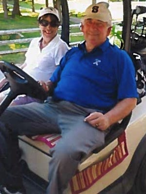 Walter C. Parshley, shown with his wife, Donna, recently pocketed a coveted hole-in-one at Cedar Hill... and the drinks were on him!