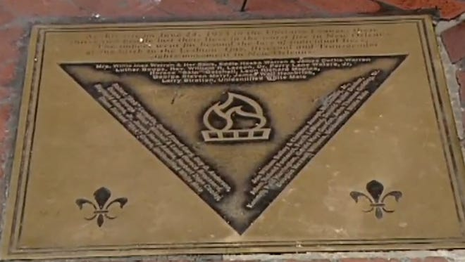 A plaque honors the victims of the 1973 fire in the Upstairs Lounge in New Orleans.