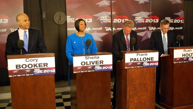 In this photo provided by WBGO, Democratic U.S. Senate candidates prepare to debate on Aug. 8 in Newark. They are, from left, Newark Mayor Cory Booker, State Assembly Speaker Sheila Oliver, and U.S. Reps. Frank Pallone and Rush Holt.