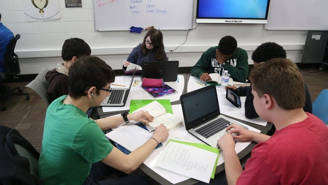 A freshmen English class uses the model classroom at North Farmington High School. The model classroom was set up with new furniture and technology. If passed by voters, a Farmington Public Schools bond proposal would pay to update the district's buildings.