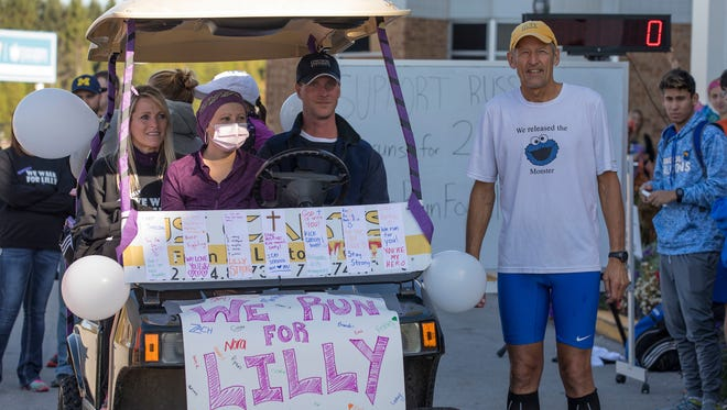 Prior to the run, Russ De Lap stands with Lilly Johnson (in golf cart, center), her mother (left) and Brett Liljegren (right), husband of a Concordia University Wisconsin staff member.