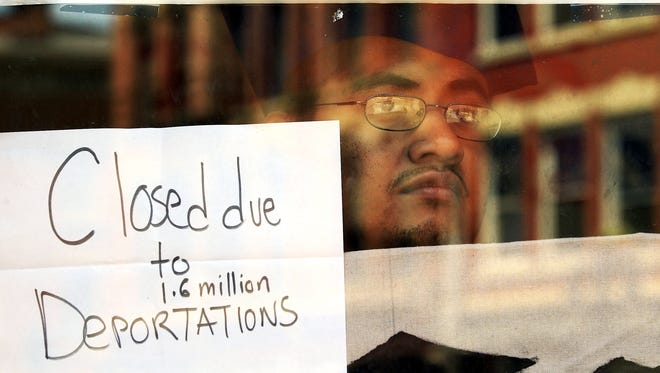 Marco Saavedra looks through a window at President Obama's Walnut Hills campaign headquarters on June 15, 2012. The office had been closed since Saavedra and other protestors held a sit-in there on June 13.