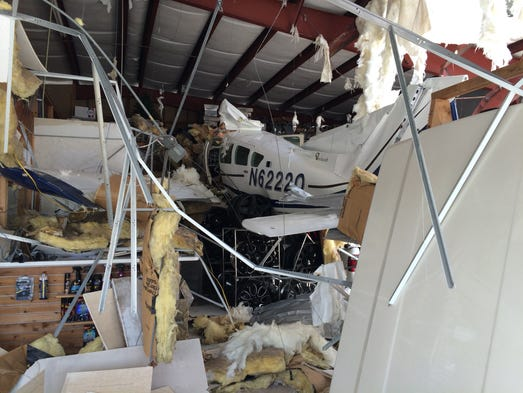 Two people aboard a small, single-engine airplane escaped serious injury today after the aircraft crashed into a Titusville repair shop, authorities report.  The crash happened about 11:50 a.m. today (July 10, 2014) shortly after the Beechcraft Sierra aircraft developed an engine problem and struck the American Paint and Body shop in the 2200 block of Garden Street, said Scott Gaenicke, spokesman for the Titusville Fire Department.