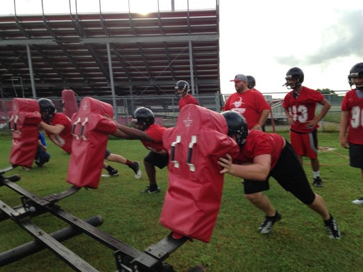 SFMHS players go through a sled drill