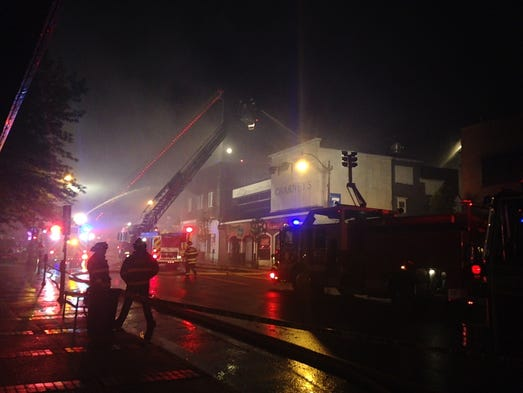 Dozens of firefighters are battling a blaze at East Coast Gamers on Robbins Street.