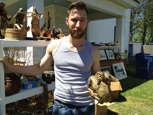 Brian Anderson holds an Egyptian ram statue passed down from his late mother. Anderson plans to have another yard sale in a month or so.