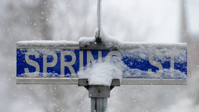 Spring St street sign is covered in snow in Lodi on Wednesday morning March 21, 2018.