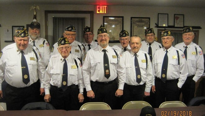 American Legion Post 33 Honor Guard members were celebrated for their volunteer work during a recent spaghetti dinner. Pictured are, first row, from left Gene Greening, Vern Reinhardt, Richard Martin, Bob Borszich (Commander), Michael Burr, guest John Burr; second row, Bruce Schinke, Gail Minks, Mark Jung, John Hinchley, Mike Dart and Clarey Reinhart.