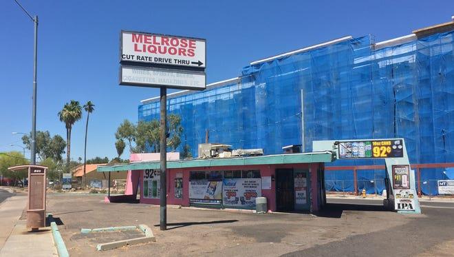 Melrose Liquors is a drive-through liquor store on Seventh Avenue, one of Phoenix's oldest drive-through liquor stores continuously in operation.