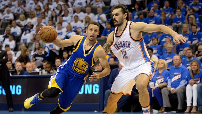 Golden State Warriors guard Stephen Curry (30) drives to the basket as Oklahoma City Thunder center Steven Adams (12) defends. Adams has been much improved in the playoffs and helped the Thunder in their quest for the Finals.