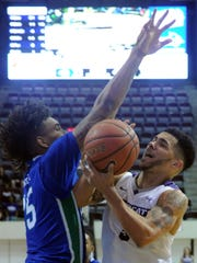 ACU's Tevin Foster, right, drives to the basket as Texas A&M-Corpus Christi's Sean Rhea defends. The Islanders beat ACU 76-67 on Thursday, Feb. 22, 2018 at Moody Coliseum.