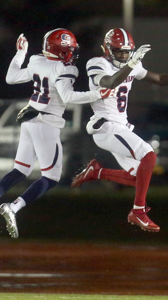 Stepinac's Trill Williams, right, celebrates with teammate