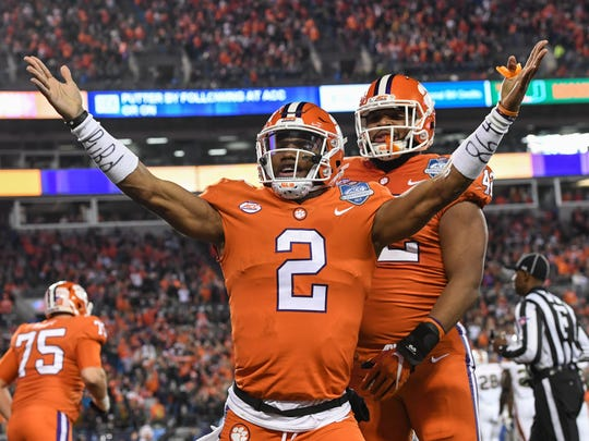 Clemson quarterback Kelly Bryant celebrates with Christian Wilkins after scoring against Miami during the first quarter of the ACC championship game against Miami at Bank of America Stadium in Charlotte on Saturday, December 2, 2017.