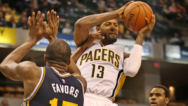 Pacers #13 Paul George controls the ball over Utah's #15 Derrick Favors during the Utah Jazz at Indiana Pacers game, Saturday, October 31, 2015.  The Jazz won 97-76.