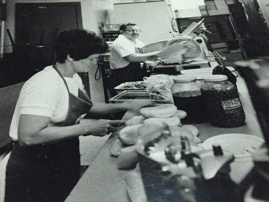 Jimmy and Barbara Hackett work behind the counter at Leo & Jimmy's Deli in downtown Wilmington in this undated photo. Jimmy Hackett, who died Friday, opened the business more than 50 years ago.
