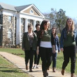 From left, Irish intern teachers Ciara Griffin, Lisa Hardiman, Lauren Furey, Mairead Hoban and Aisling O'Hara walk to one of the buildings at St. Christopher's School's Jennie Clarkson Campus in Valhalla on April 10, 2014.